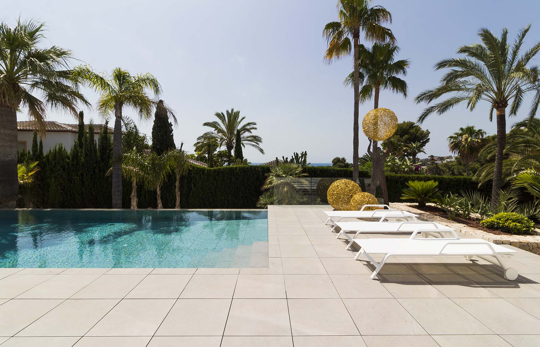 Swimming pool and sea views from the villa at the Costa Blanca. Mediterranean Sea